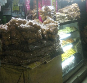 "Piles of packets of ""Moa""--balls of puffed rice stuck together with sticky jaggery."
